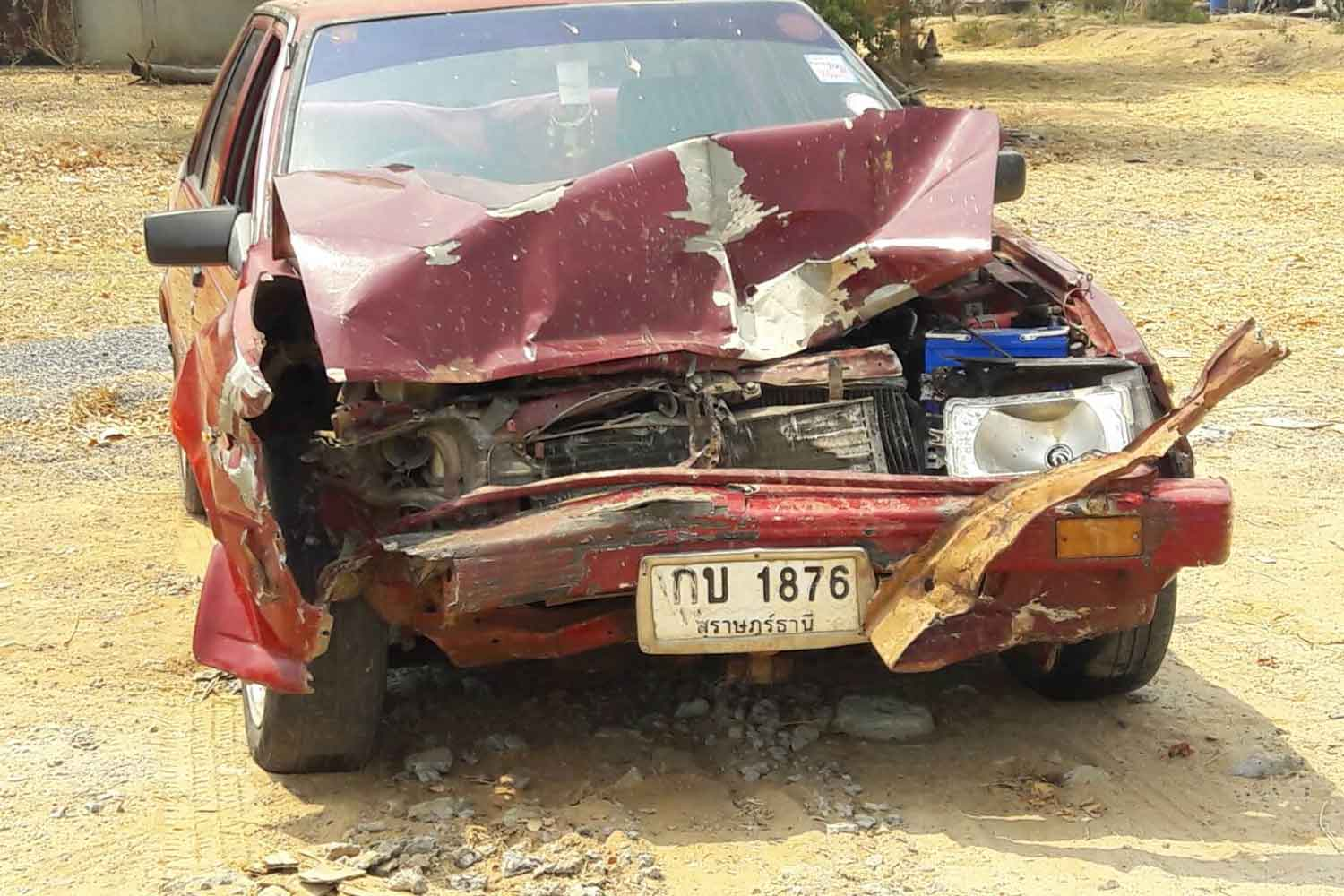 The Nissan Sunny, driven by a monk, after it rear-ended a pickup in Phimai on Sunday. A woman travelling on the back of the pickup was killed. (Photo by Prasit Tangprasert)