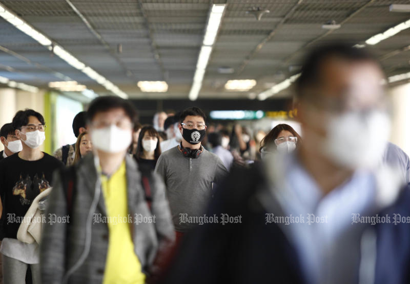 Travellers are seen at Don Mueang airport on Feb 7. The Public Health Ministry announced on Tuesday nine countries and two territories are Covid-19 high-risk zones. (Photo by Pattarapong Chatpattarasill)