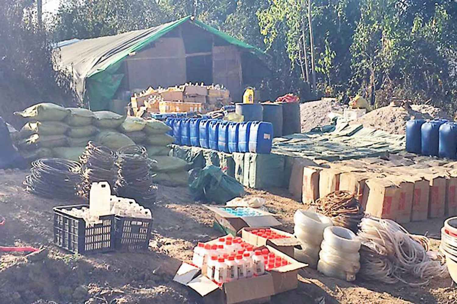 Some of the hundreds of containers of chemicals and precursors found at the plant in Kutkai township of the Shan State of Myanmar, raided by the Myanmar armed forces last Friday. (Photo supplied)