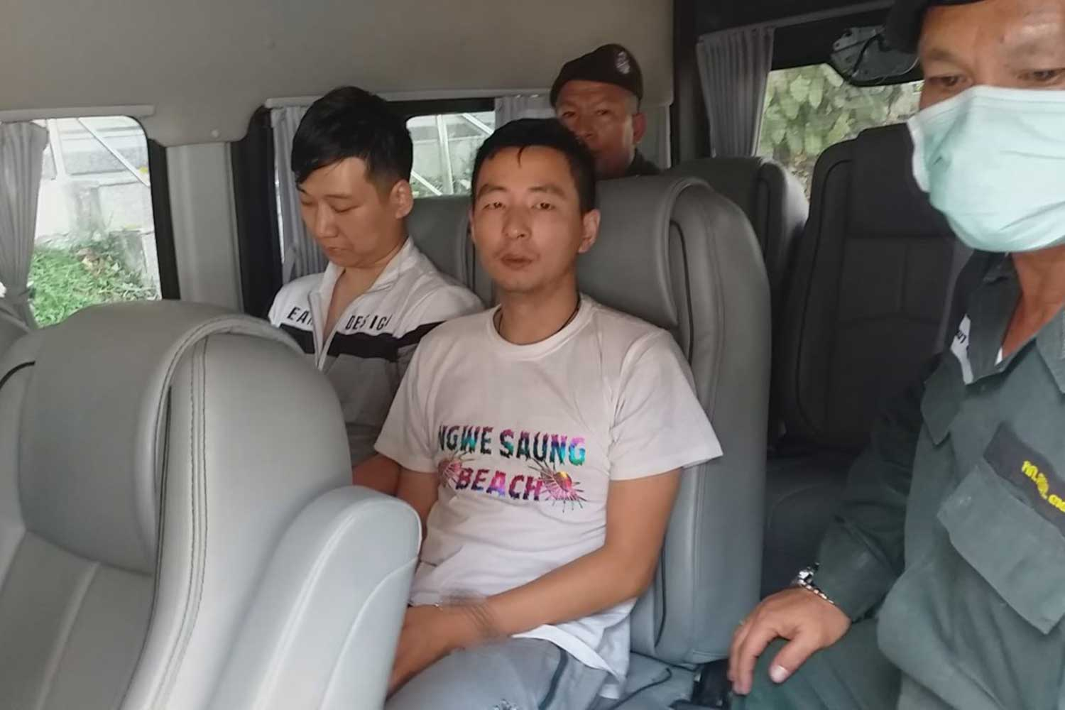 Chinese nationals Fan Gang Gang and Qin Miao are taken from Myanmar's Myawaddy border town to Mae Sot district of Tak on Wednesday following their arrest in Rangoon. Myanmar immigration police have reportedly now arrested the other two Chinese suspects in the Ping River suitcase murder case. (Photo by Assawin Pinitwong)