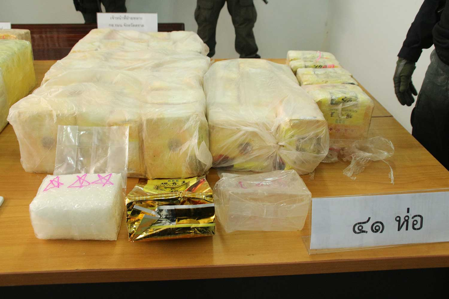 Crystal methamphetamine seized on Koh Krut was contained in green-tea packages with Chinese and English lettering. (Photo taken from Trat provincial police Facebook page)