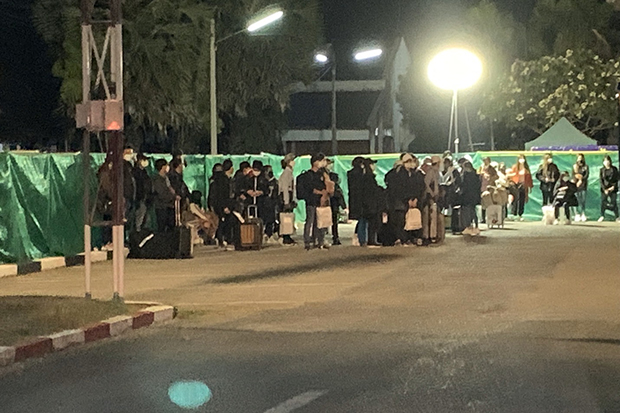 Thai workers arrive at a reception centre of the Royal Thai Navy in Sattahip district of Chon Buri in the early hours of Sunday for a 14-day quarantine. (Royal Thai Navy photo)