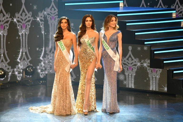 Finalists (left to right) Brazil's Ariella Moura, Thailand's Ruethaipreeya Nuanglee and Mexico's Valentina Fluchaire compete in the Miss International Queen 2020 contest. (AFP photo)