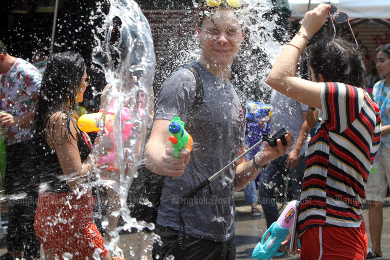 Revellers get wet during the Songkran party on Khao San Road on April 13, 2018 - the last time it was held. The Covid-19 threat has caused organisers to again cancel the festivities this year. (Photo by Apichart Jinakul)