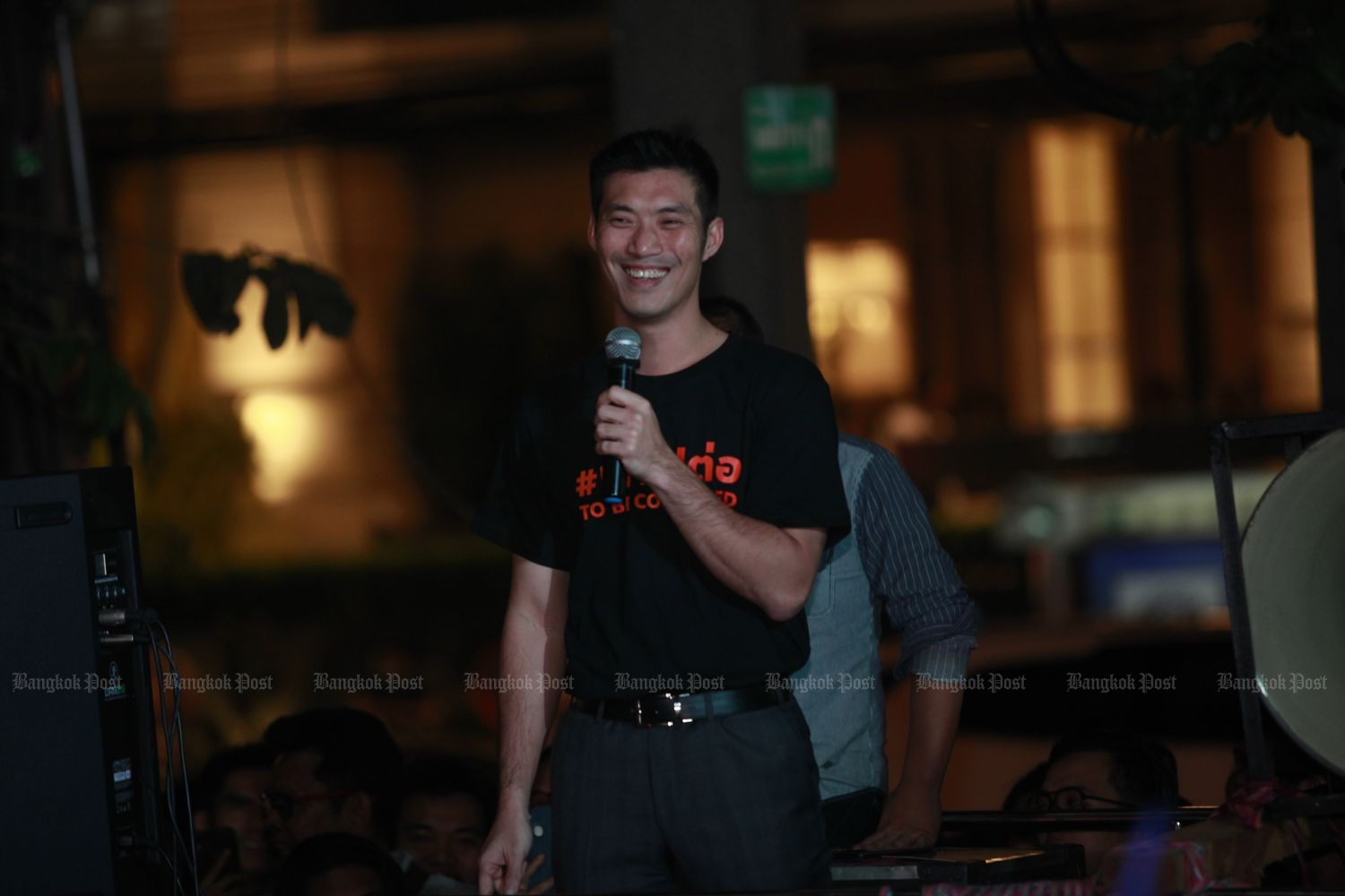 Thanathorn Juangroongruangkit, leader of the dissolved Future Forward Party, addresses his supporters near Thai Summit Tower in Bangkok shortly after midnight of Feb 21. He announced the Future Forward Movement after the Constitutional Court's dissolution of the party. (Photo by Nutthawat Wicheanbut)