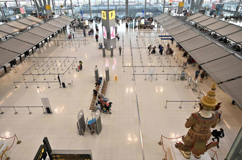 A general view of the almost empty departure hall of Suvarnabhumi Airport in Bangkok on Tuesday, as visitor numbers have plummeted in the region over the spread of the Covid-19 coronavirus. (AFP photo)