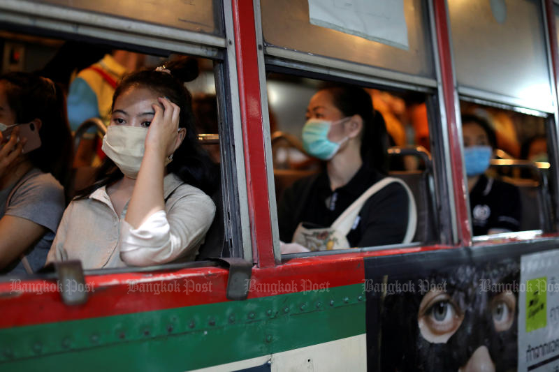 Women travel in a public bus wearing protective masks due to the coronavirus outbreak, in Bangkok on Monday. (Reuters photo)