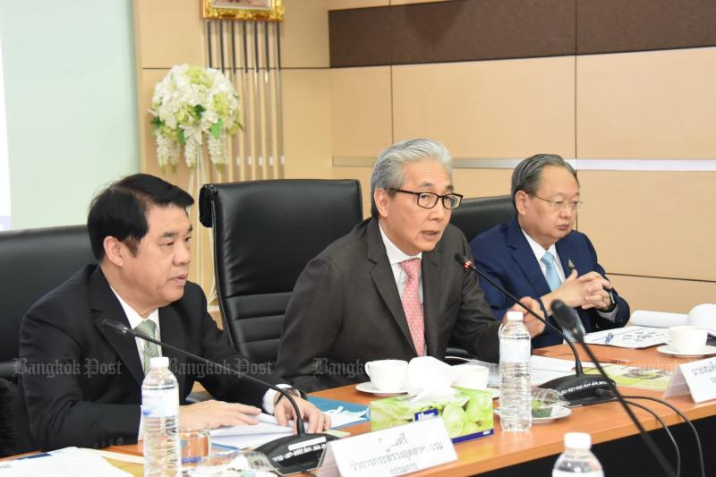 From left Industry Minister Suriya Juangroongruangkit, Deputy Prime Minister Somkid Jatusripitak and Energy Minister Sontirat Sontijirawong present the national EV plan.