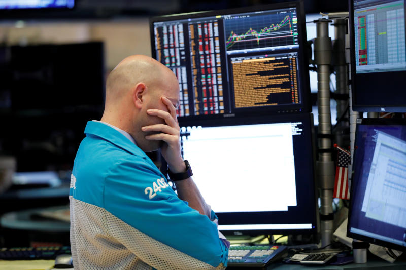 A trader reacts as share prices fall on the New York Stock Exchange in New York on Wednesday. Thai shares also dropped in morning trading on Thursday.(Photo: Reuters)