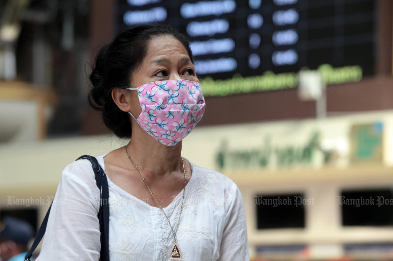 A woman waits for a train at Hua Lamphong station on March 5, 2019. The coronavirus spread continues to put pressure on the Stock Exchange of Thailand index on Thursday. (Photo by Chanat Katanyu)