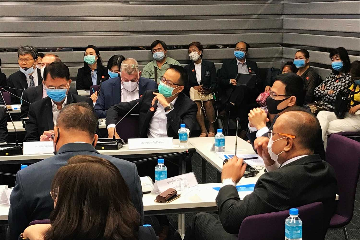 A meeting at the Office of the Insurance Commission sees all participants wearing masks as a precaution as many insurers offer Covid-19 products.