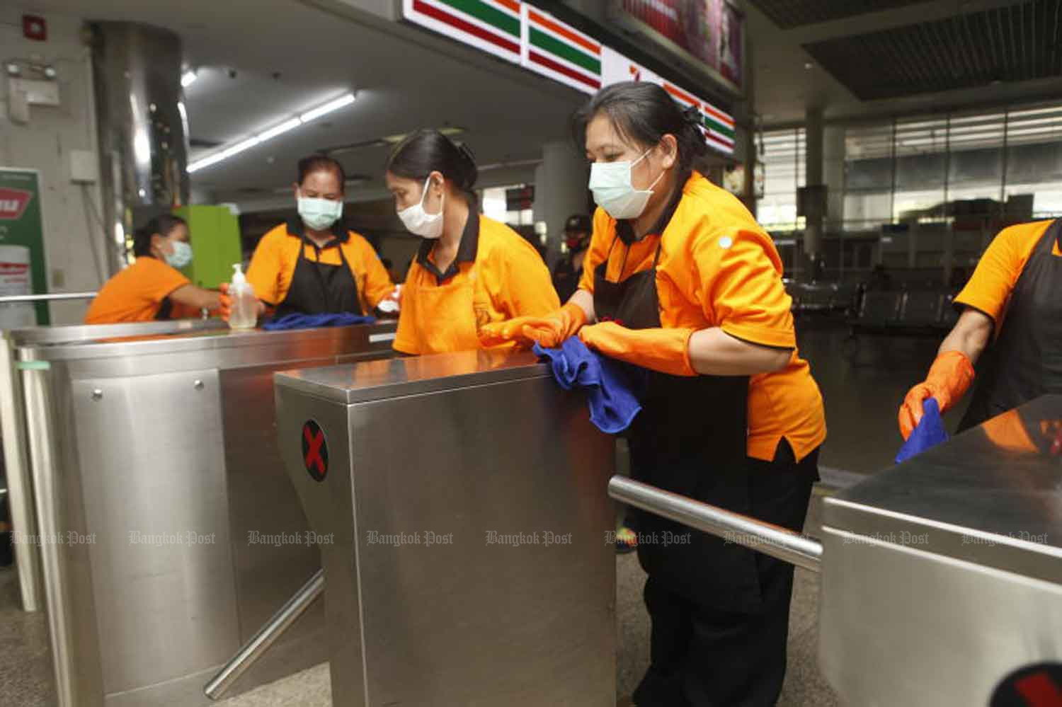 Staff busily clean Mor Chit bus terminal in Chatuchak district of Bangkok on Friday, when the Public Health Ministry announced five new local Covid-19 cases. (Photo: Nutthawat Wicheanbut)