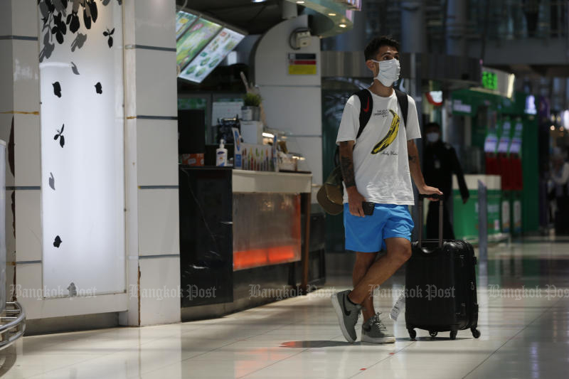 A traveller is seen at Suvarnabhumi airport on Thursday. (Photo by Pornprom Satrabhaya)