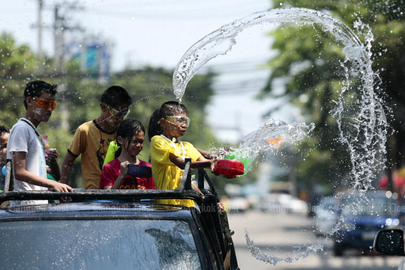 Children take part in a water war during the Songkran festival in Soi Sukhumvit 101 on April 14, 2018. The government plans to postpone the holiday this year to control the spread of the new coronavirus. (Photo by Patipat Janthong)