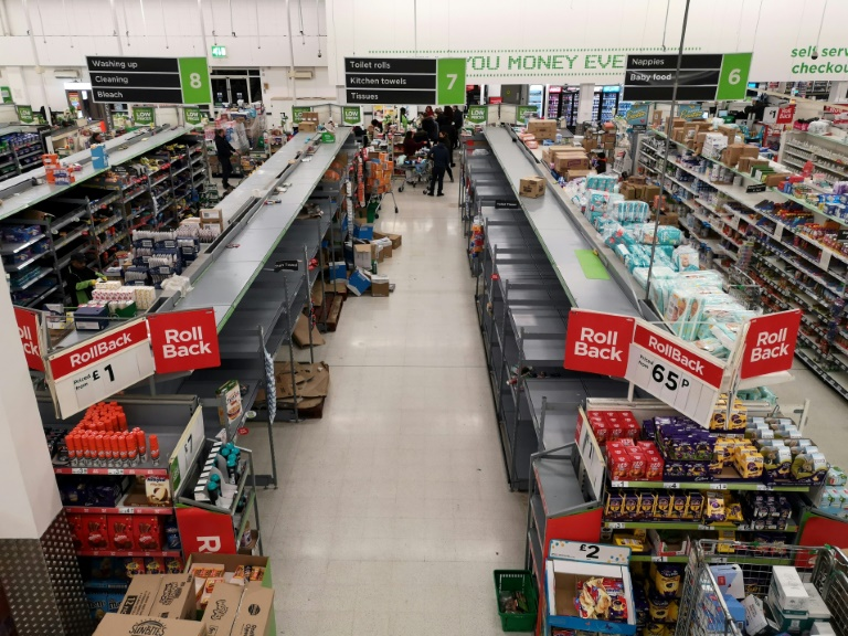 Empty shelves in the toilet roll/kitchen towel aisle of a supermarket in London on March 13. (Photo: AFP)