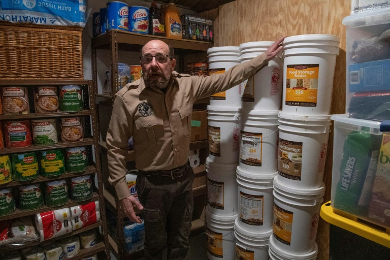 Fortitude Ranch Chief Operating Officer Steve Rene shows a storage room stacked with food in Mathias, West Virginia