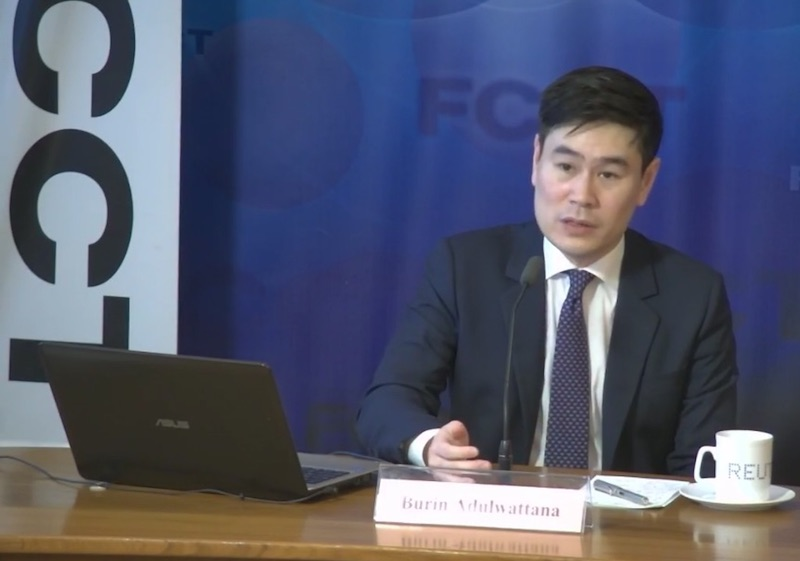 Bangkok Bank chief economist Burin Adulwattana speaks at the Foreign Correspondents' Club of Thailand in Bangkok on Wednesday evening. (Screenshot from FCCT Facebook page)