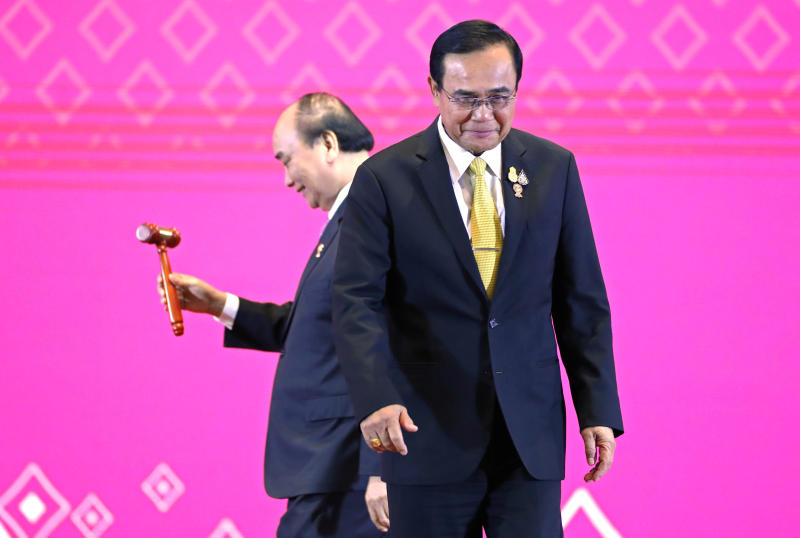 Vietnamese Prime Minister Nguyen Xuan Phuc holds the gavel after Prime Minister Prayut Chan-o-cha handed over the Asean chairmanship to Vietnam during the closing ceremony of the 35th Asean Summit and related summits in Bangkok on Nov 4, 2019. (Reuters photo)
