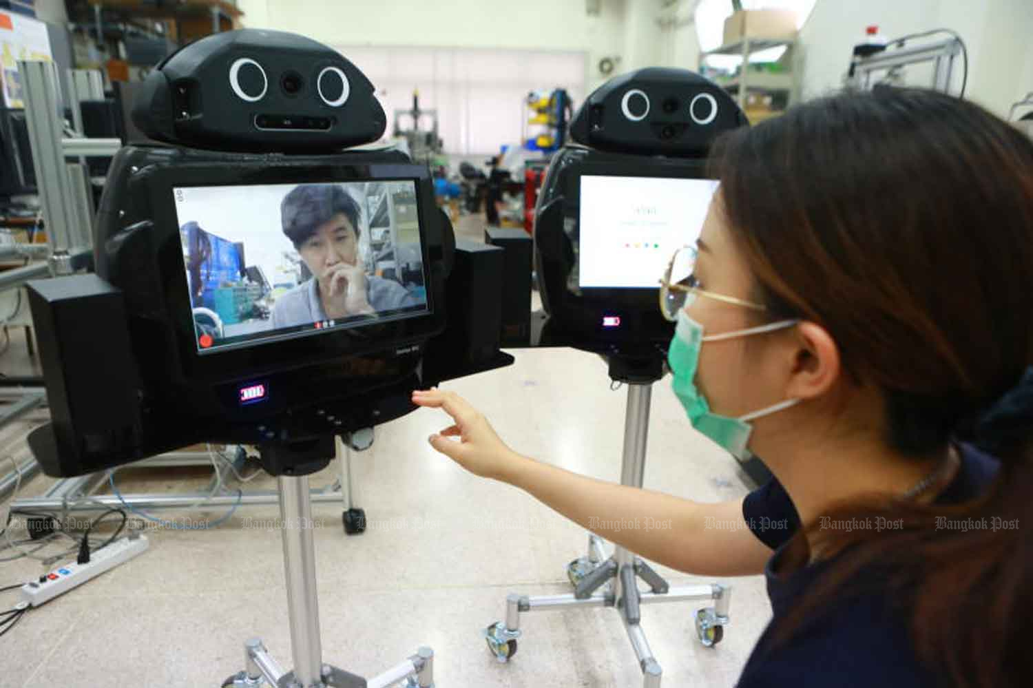 'Ninja', a telemedicine robot developed by a Chulalongkorn University research team, is tested at the university's engineering faculty. The robot will be used by medical personnel to lend to Covid-19 patients by providing real-time information from their bedside. (Photo: Somchai Poomlard)