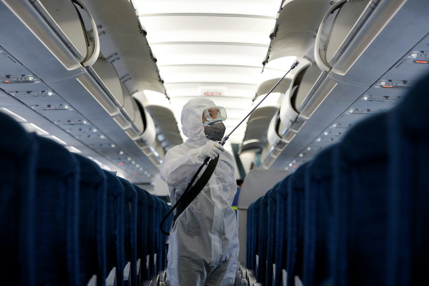 A health worker sprays disinfectant inside a Vietnam Airlines plane at Noi Bai airport in Hanoi. (Reuters Photo)