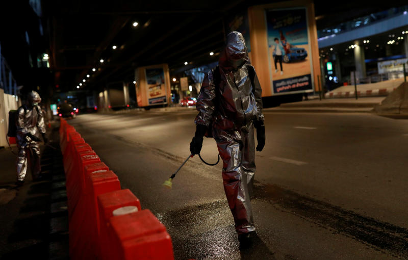 Royal Thai Army soldiers sanitise city streets on Saturday due to the coronavirus disease outbreak in Bangkok. (Reuters photo)