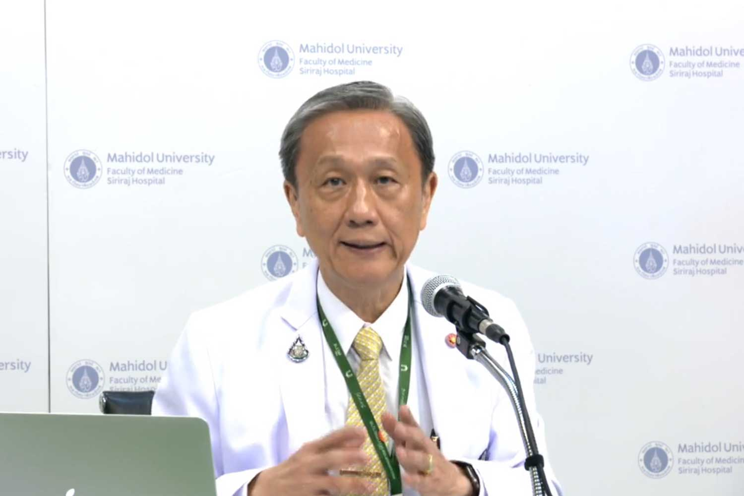 Prof Dr Prasit Watanapa, dean of the faculty of medicine Siriraj Hospital of Mahidol University, warns of the need for strict social-distancing, on the university's online TV channel on Monday. (A screenshot from the channel)