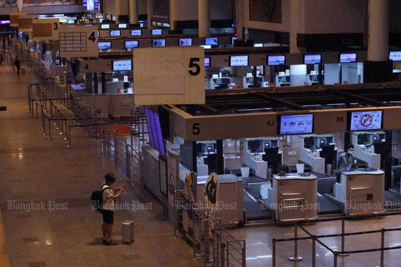 A passenger is seen at Don Mueang on March 13, 2020 as the airport is quiet after countries limit travel restrictions. (Photo by Arnun Chonmahatrakool)