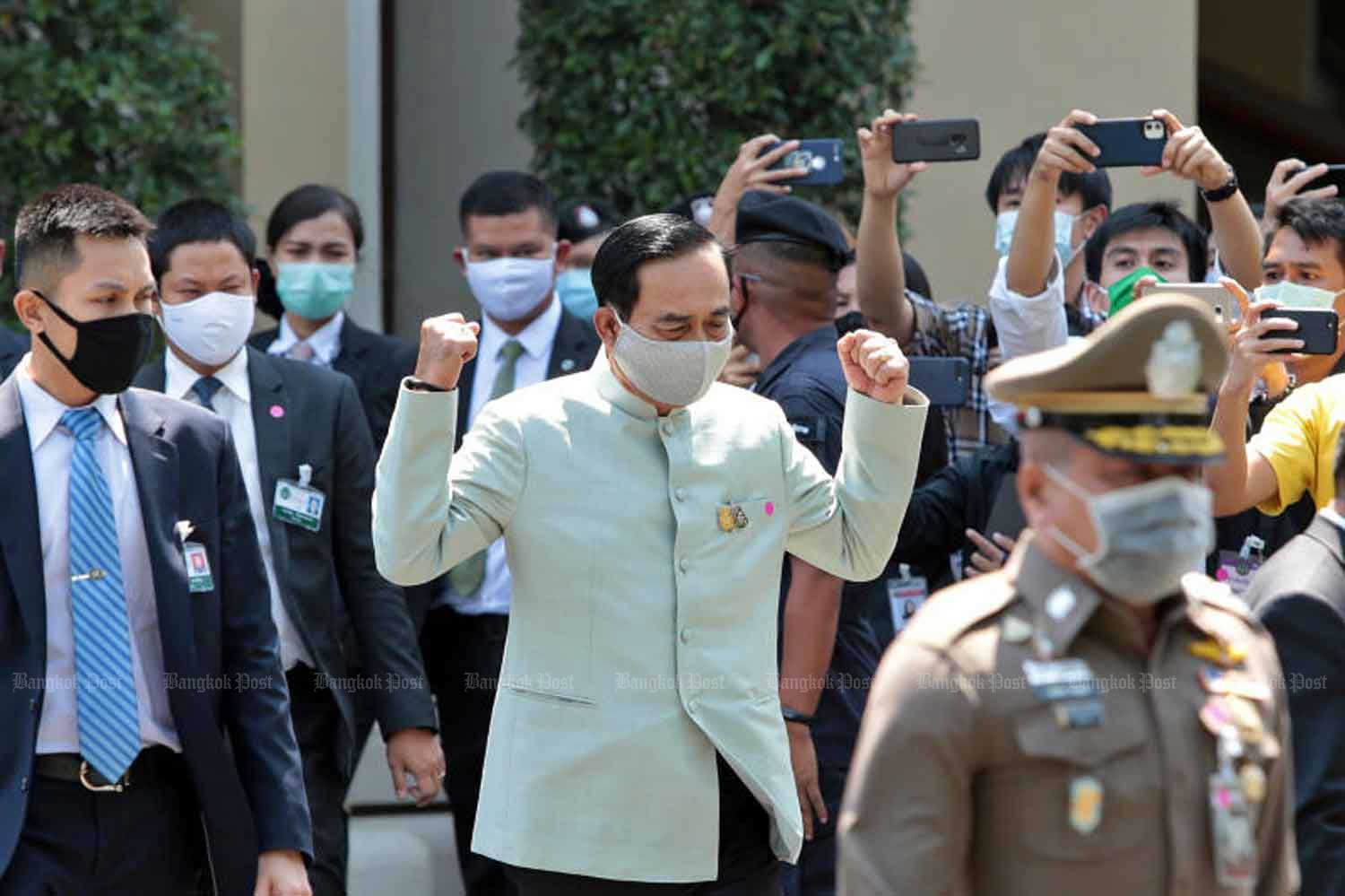 Prime Minister Prayut Chan-o-cha gestures after announcing the government's plan to declare an emergency and impose measures to control the Covid-19 pandemic, at Government House in Bangkok on Tuesday. (Photo: Chanat Katanyu)
