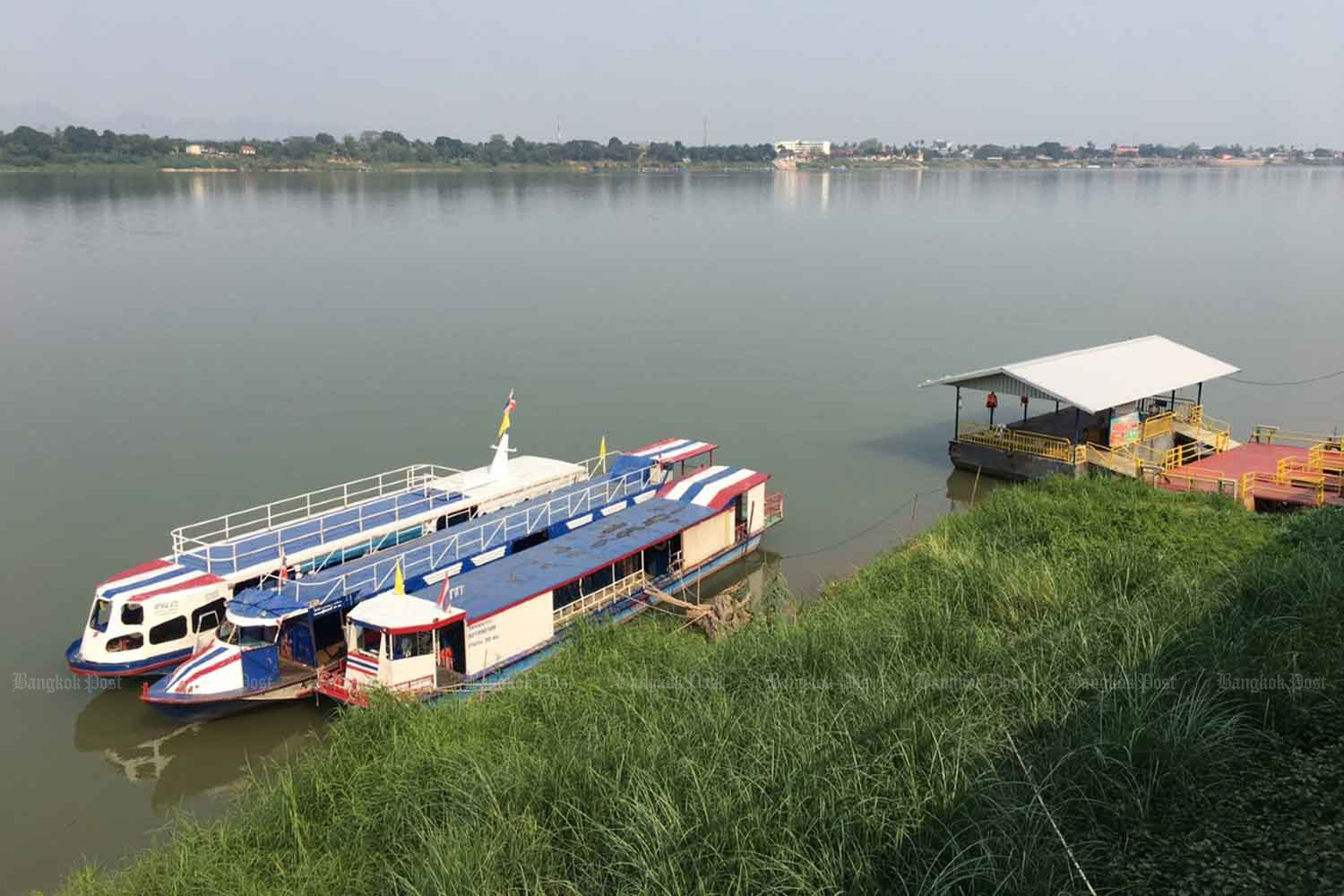 Passenger boats moor at a pier in Nakhon Phanom's Muang district. Boat services across the Mekong river between Thailand and Laos in Nakhon Phanom have come to a halt after the border was closed.