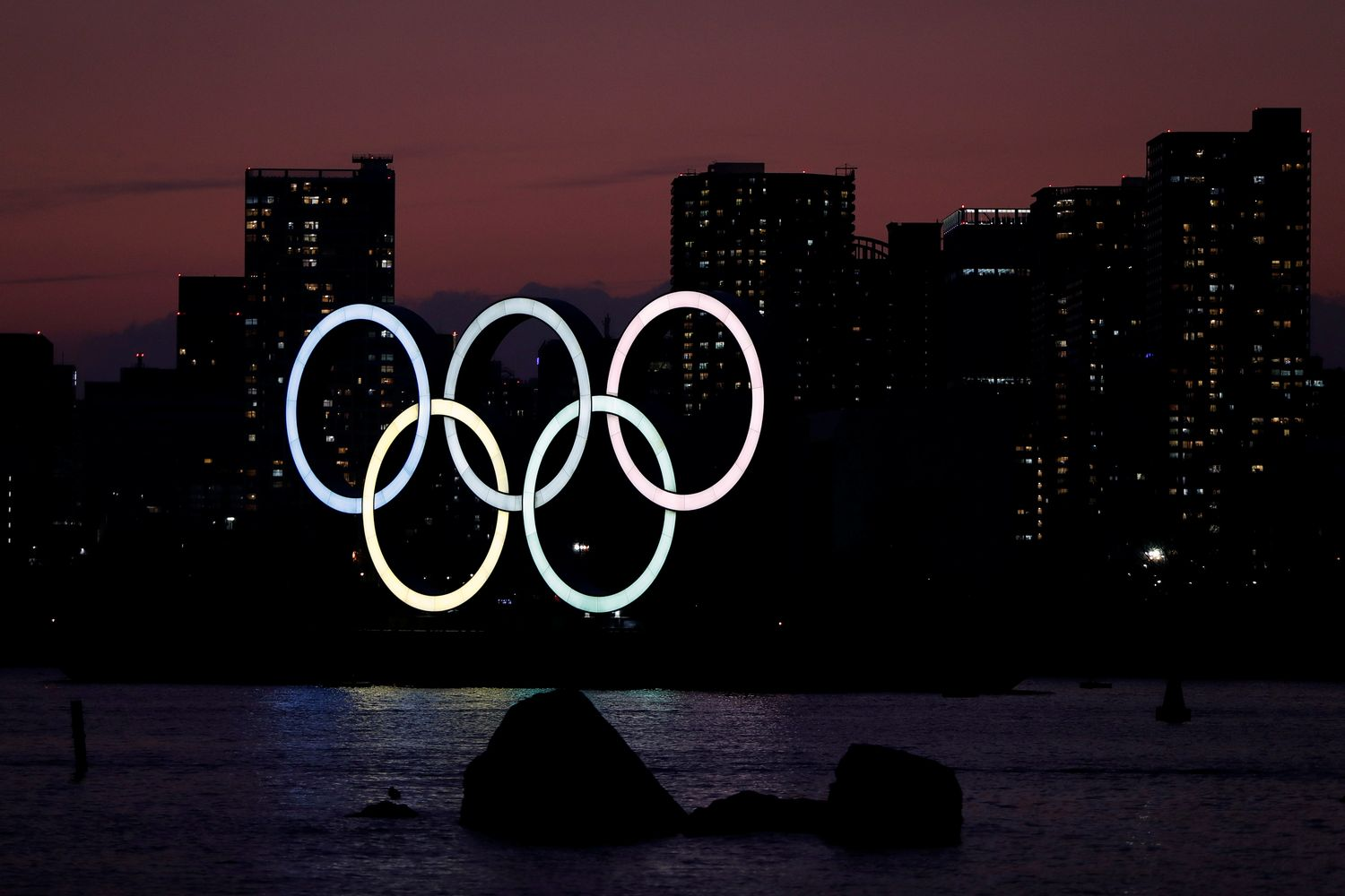 The giant Olympic rings are seen in the dusk at the waterfront area at Odaiba Marine Park in Tokyo on Sunday. (Reuters photo)