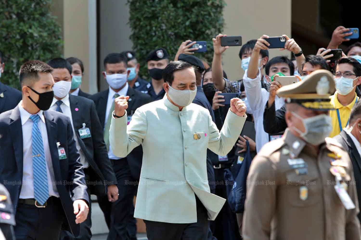 Prime MInister Prayut Chan-o-cha, centre, gestures after announcing the government will exercise emergency measures to control Covid-19. (Photo: Chanat Katanyu)
