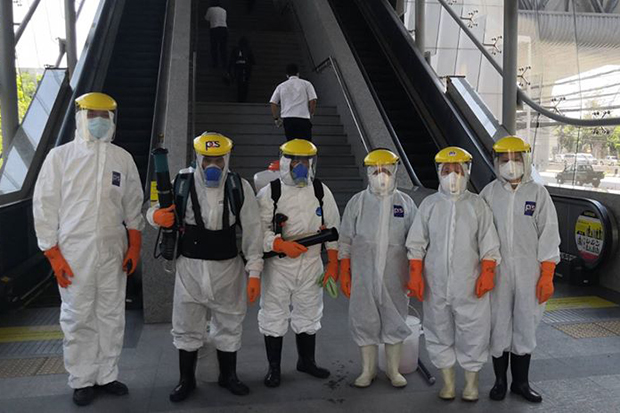 Officials pose for a photo after spraying the Nonthaburi Civic Center Station on the Purple Line with disinfectant after an employee there was found to be infected with Covid-19. (Photo: MRT Bangkok Metro Facebook page)