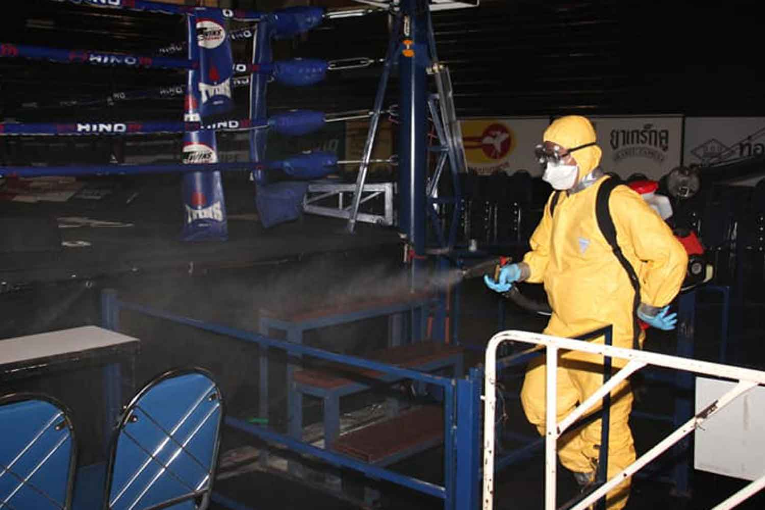 A health official sprays disinfectant at Lumpinee boxing stadium in Bang Khen district, Bangkok, on March 15. The rapid spread of Covid-19 has been partly blamed on the army's decision to ignore warnings and go ahead with boxing at the stadium on March 6. (Photo: Lumpinee stadium Facebook)