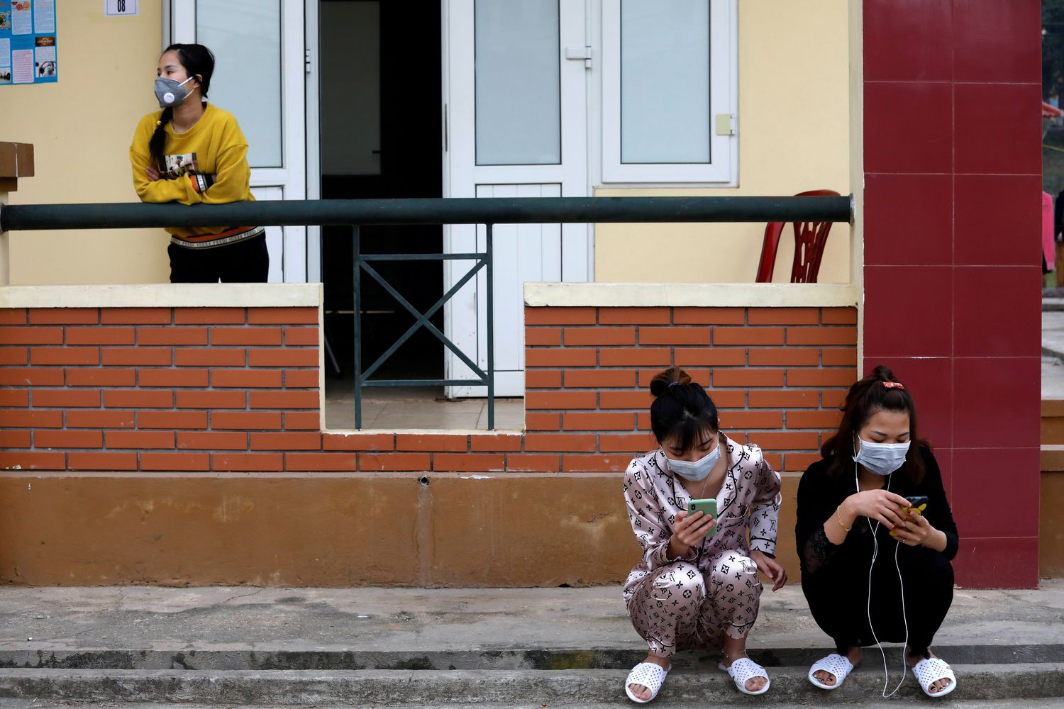 Vietnamese people who come back from China are seen inside a quarantine area at a military base in Lang Son province, Vietnam, on Feb 20. (Reuters photo)