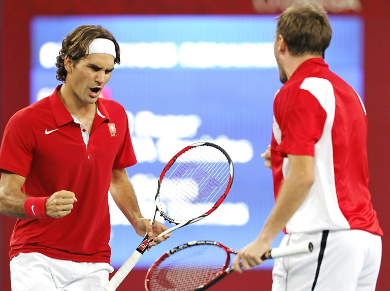 Way back when: Roger Federer and Stan Wawrinka celebrate after winning Olympic gold in the men's doubles in 2008 at Beijing.