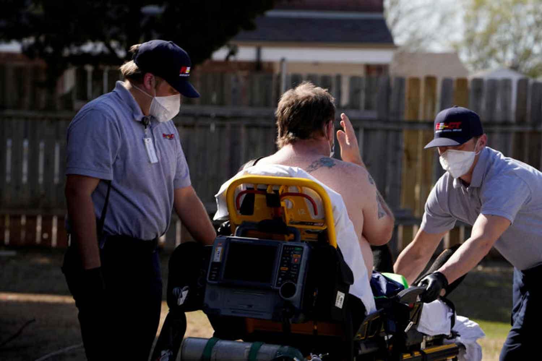 Paramedics prepare to transport a potential coronavirus disease (Covid-19) patient in Shawnee, Oklahoma, US, on Thursday. (Reuters photo)