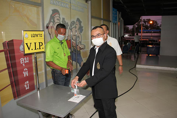 Maj Gen Rachit Arunrangsi, who is in charge of Lumpinee Boxing Stadium, cleans his hands with satiniser before entering the arena on March 6, 2020. (Photo: Lumpinee Boxing Stadium Facebook account)