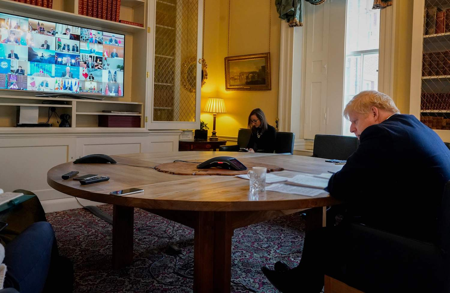 Prime Minister Boris Johnson participates in a video conference with other G20 leaders in the study of 10 Downing Street in London on Thursday. (Handout photo via AFP)