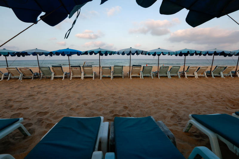 Empty chairs are seen on a beach that was normally full of tourists, as coronavirus fears mounted in Phuket, on March 11. (Reuters photo)