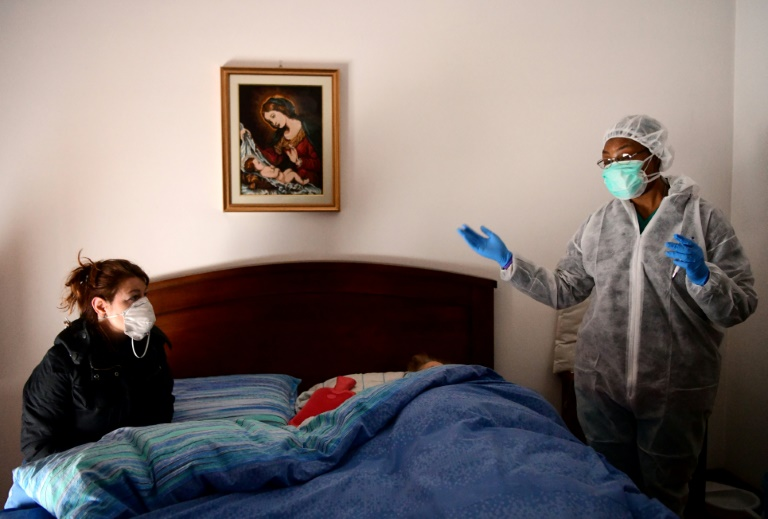 Italy recorded almost 1,000 deaths from the virus on Friday, the worst one-day toll anywhere around the world since the pandemic began. (AFP Photo)