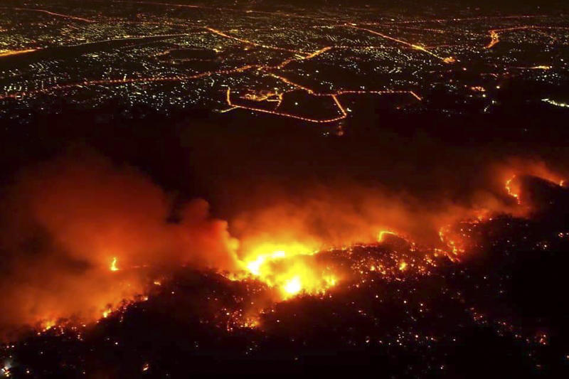 A bushfire ravages Doi Suthep-Pui National Park in Chiang Mai's Hang Dong district on Wednesday night. (Photo by Chiang Mai Volunteer Drone Team)