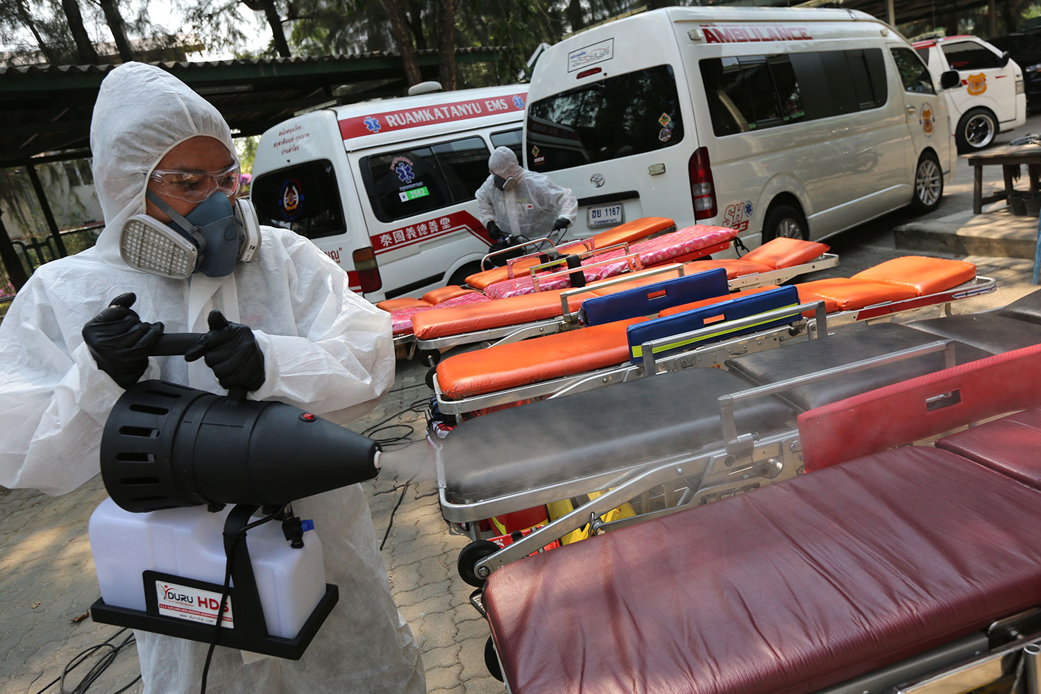 Just to be sure: A member of the Emergency Services Unit of Thailand sprays disinfectant at stretchers used by rescuers and ambulance staff to protect them against exposure to Covid-19 while transporting patients. (Photo by Wichan Charoenkiatpakul)