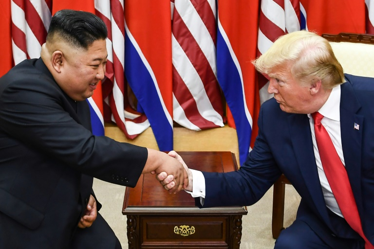 North Korean leader Kim Jong Un (L) and US President Donald Trump shake hands on June 30, 2019, during a meeting on the south side of the Military Demarcation Line that divides North and South Korea.