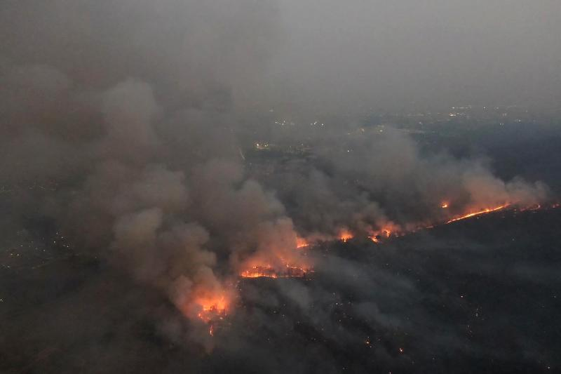 This aerial handout photo taken on March 18, 2020 and released by Thai volunteer group Jit Arsa shows smoke rising from fires in Mae Rim district in northern Chiang Mai province, where the blazes have severely impacted air quality. (AFP PHOTO / JIT ARSA)