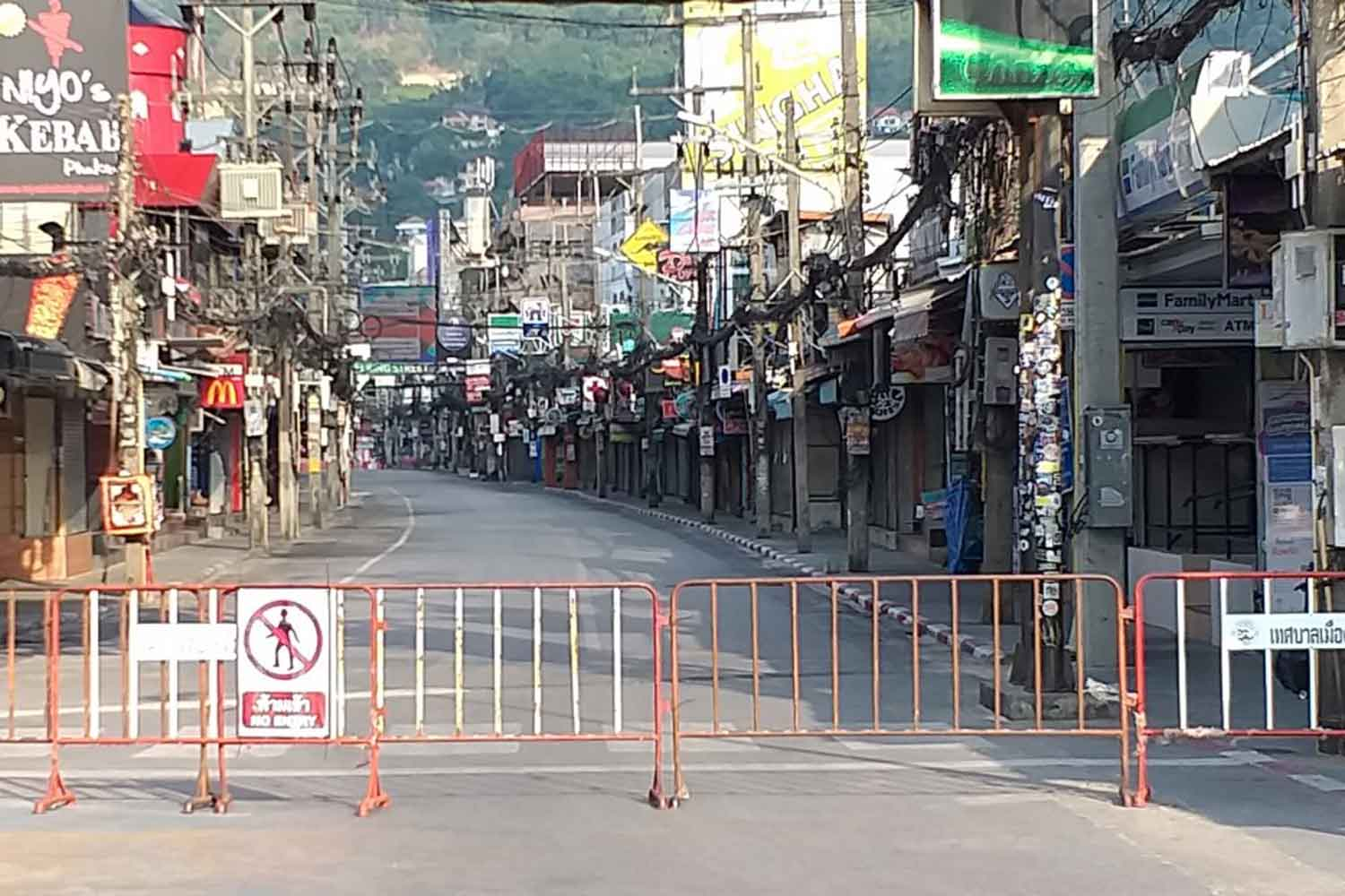 A barricade blocks entry to Soi Bangla in Phuket's Patong area, where entertainment venues have been ordered closed to stem the Covid-19 outbreak. (Photo: Achadtaya Chuenniran)