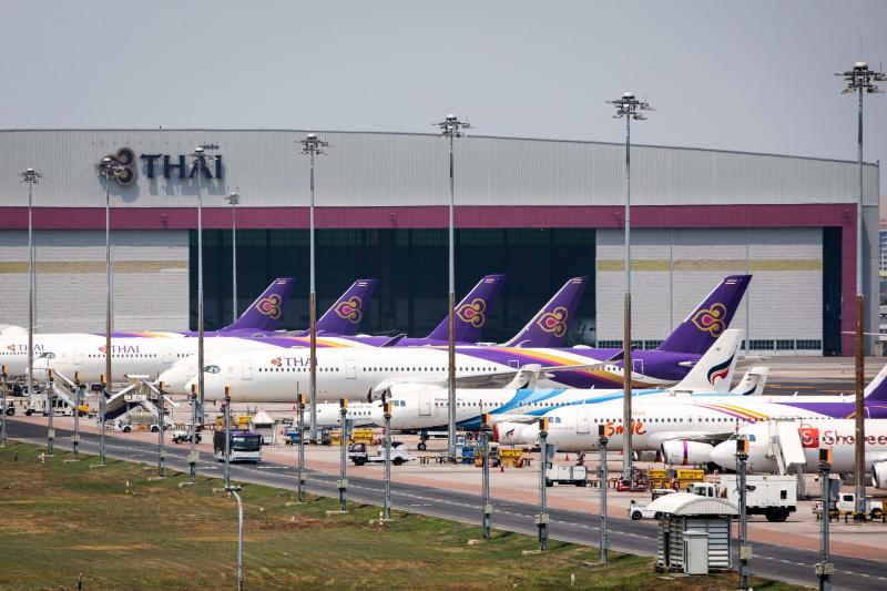 Thai Airways aircraft are parked on the tarmac at Suvarnabhumi Airport in Bangkok on March 25, 2020 after the airline suspended international flights due to the Covid-19 coronavirus. (AFP photo)