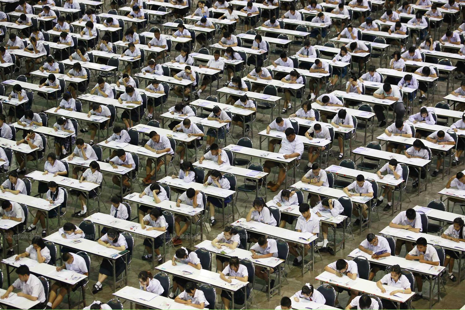 In this 2012 file photo, about 35,000 students sit for an exam in a bid to gain direct admission to Srinakharinwirot University. The test was held at at Muang Thong Thani's Impact Arena in Nonthaburi province. (Bangkok Post file photo)
