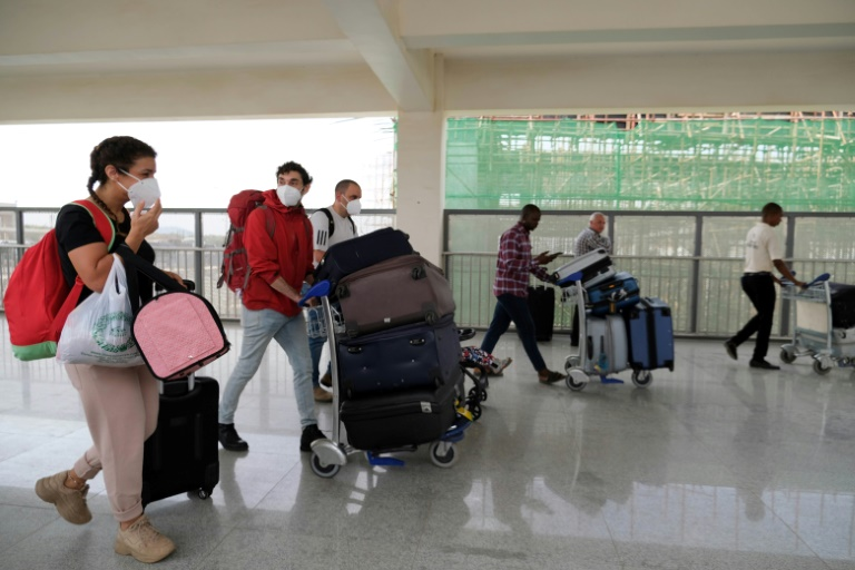 Foreign nationals were flying out of Nigeria's Abuja airport Sunday.