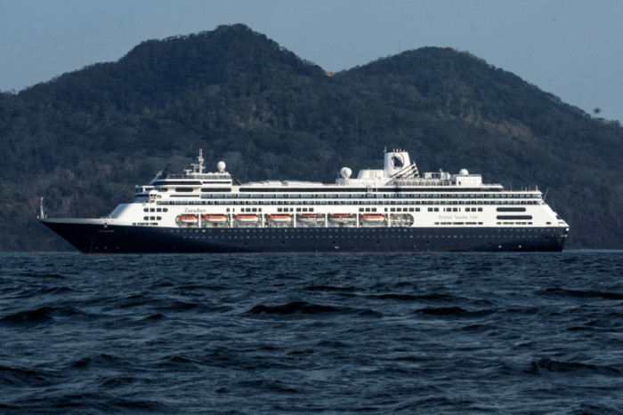Passengers on stranded virus-hit ship plead for help