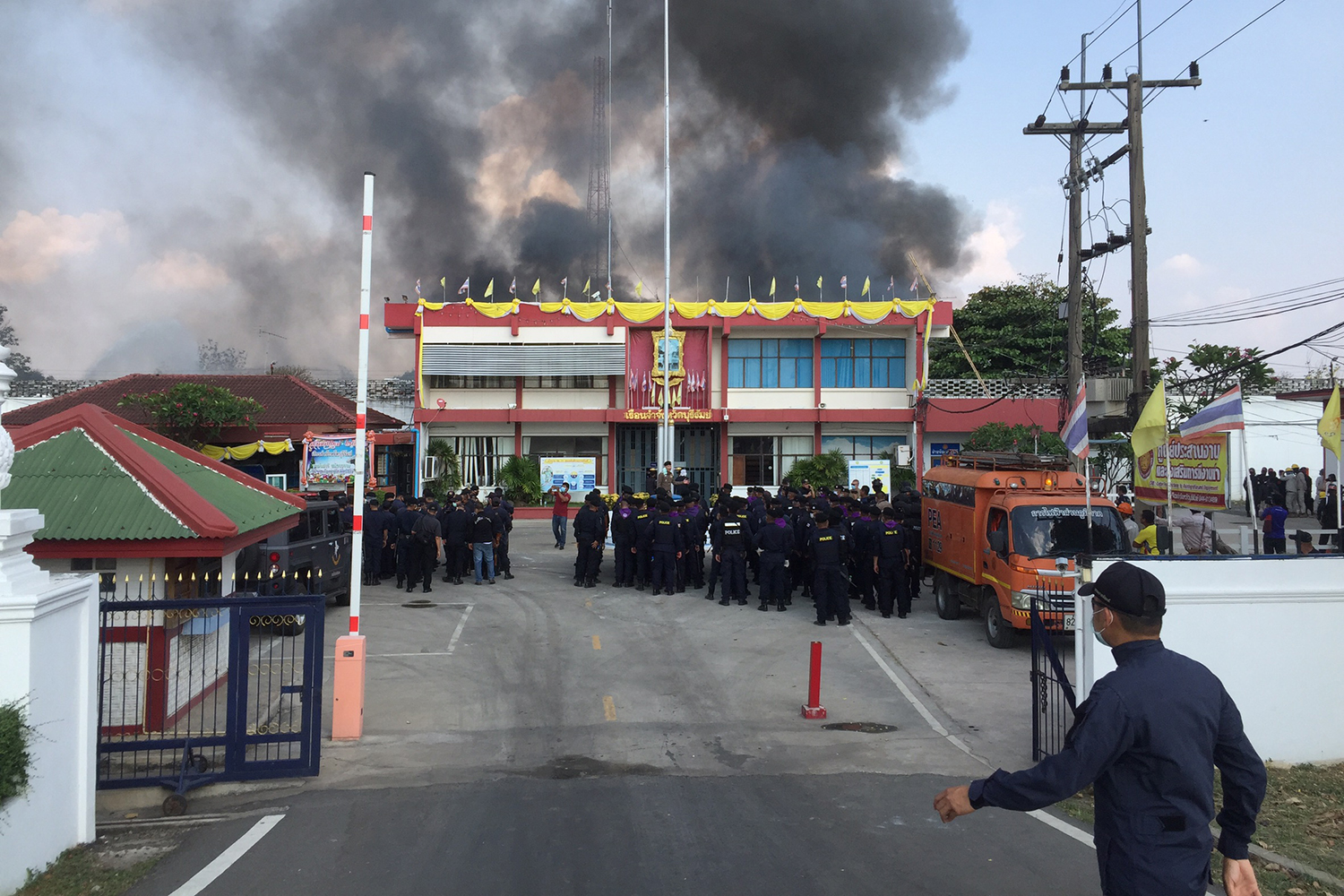 Smoke billows from the prison in Buri Ram's Muang district on Sunday during the riot. (Photo: Surachai Piragsa)